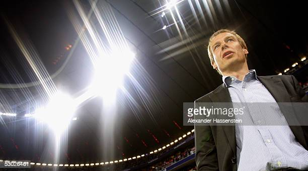 Juergen Klinsmann head coach of the German Football National Team looks on during the opening game of the Allianz Arena between Bayern Munich and...
