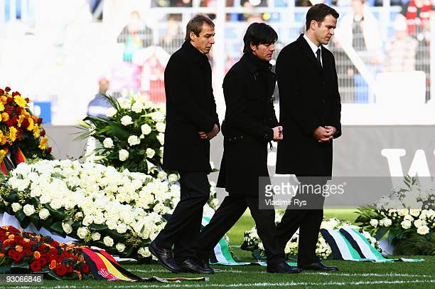 Juergen Klinsmann Joachim Loew and Oliver Bierhoff leave the coffin of their goalie Robert Enke at a memorial service prior to Enke�s funeral at AWD...