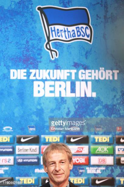 Juergen Klinsmann, newly appointed head coach of Hertha BSC Berlin, speaks to the media during a press conference on November 27, 2019 in Berlin,...