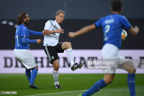 Juergen Klinsmann of DFBAllStars scores his team's second goal during the Friendly Match between the DFBAllStars and Azzurri Legends at Sportpark...