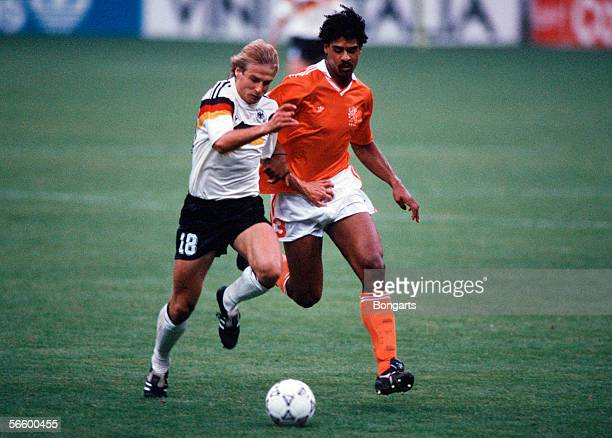Juergen Klinsmann of Germany and Frank Rijkaard of Netherlands battle for the ball during the World Cup eighth final match between Germany and...
