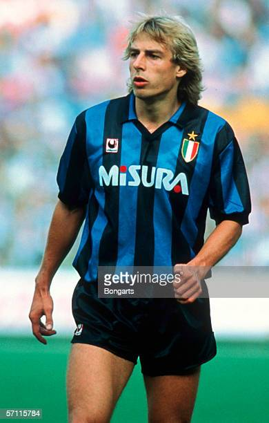 Juergen Klinsmann of Inter looks on during the Serie A match between AC Milan and Inter Milan at the Guiseppe Meazza Stadium on March 01 1990 in...