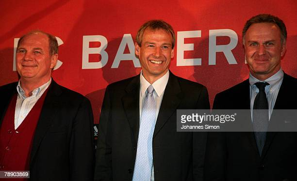 Juergen Klinsmann poses with manager Uli Hoeness and CEO KarlHeinz Rummenigge during a Bayern Munich press conference at the Arabella Sheraton hotel...