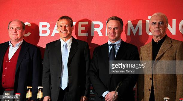 Juergen Klinsmann poses with manager Uli Hoeness CEO KarlHeinz Rummenigge and president Franz Beckenbauer pose during a Bayern Munich press...