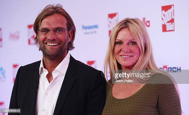 Juergen Klopp and his wife Ulla Klopp attend the Sport Bild Award 2011 at the Fischauktionshalle on August 8 2011 in Hamburg Germany