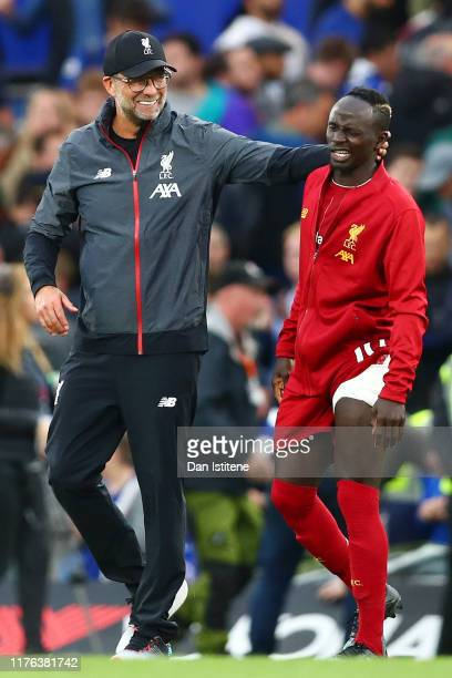 Juergen Klopp embraces Sadio Mane of Liverpool during the Premier League match between Chelsea FC and Liverpool FC at Stamford Bridge on September 22...