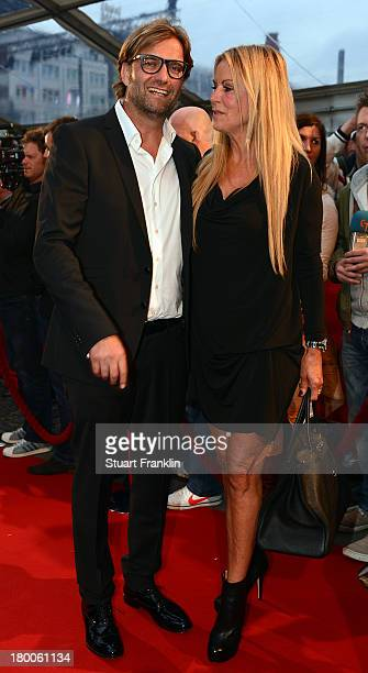 Juergen Klopp head coach of Borussia Dortmund arrives with his wife Ulla Klopp at the evening gala at Schmidt theater after the day of the legends...