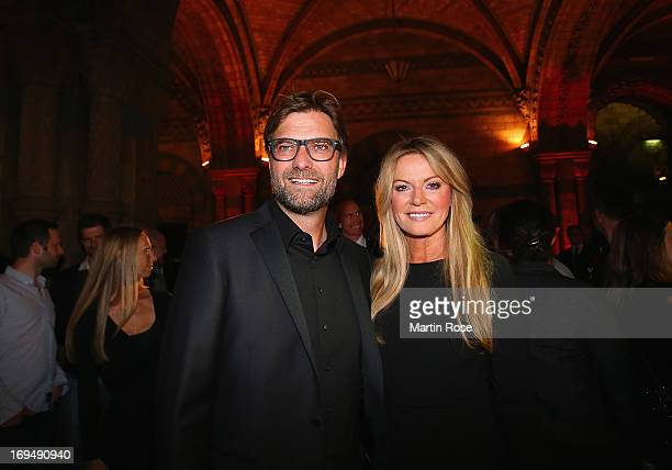 Juergen Klopp head coach of Borussia Dortmund poses with his wife Ulla during the Champions Party after the Champions League Final match against...