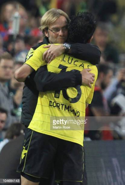 Juergen Klopp head coach of Dortmund celebrate with Lucas Barrios during the Bundesliga match between Borussia Dortmund and FC Bayern Muenchen at the...
