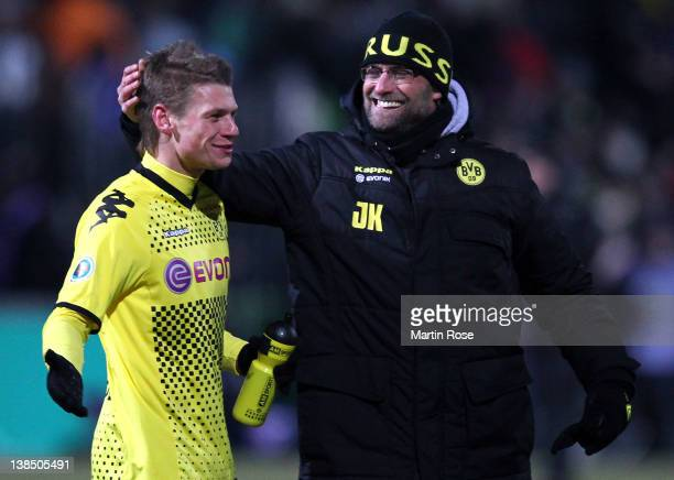 Juergen Klopp , head coach of Dortmund celebrate with Lukasz Piszczek after the DFB Cup Quarter Final match between Holstein Kiel and Borussia...