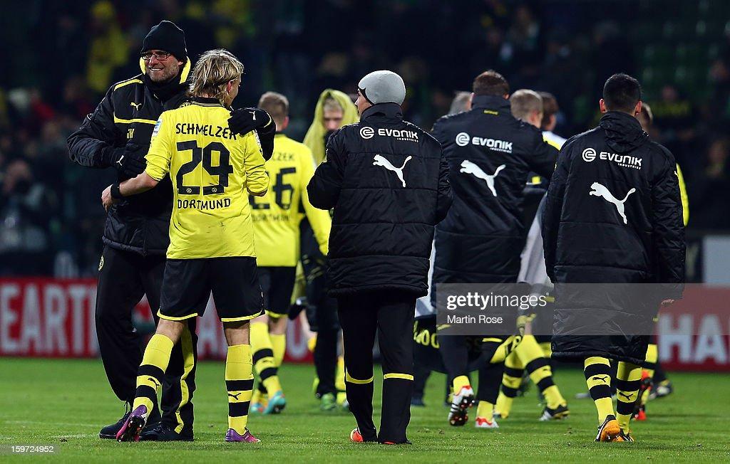 Juergen Klopp, head coach of Dortmund celebrate with Marcel Schmelzer after the Bundesliga match between Werder Bremen and Borussia Dortmund at Weser Stadium on January 19, 2013 in Bremen, Germany.