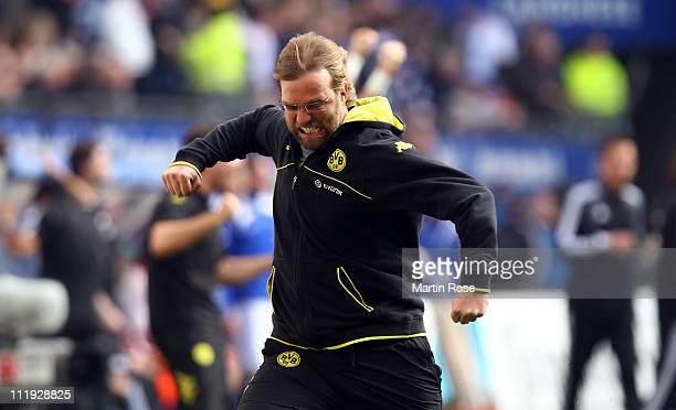 Juergen Klopp head coach of Dortmund celebrates his team's equalizing goal during the Bundesliga match between Hamburger SV and Borussia Dortmund at...