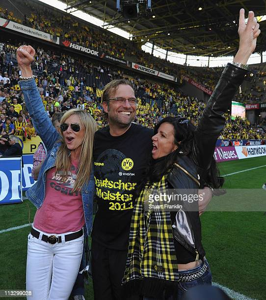 Juergen Klopp head coach of Dortmund celebrateswith his wife Ulla and a friend winning the league title at the end of the Bundesliga match between...