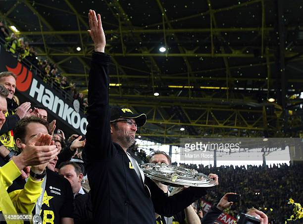 Juergen Klopp head coach of Dortmund lifts the trophy after winning the german championship after the Bundesliga match between Borussia Dortmund and...