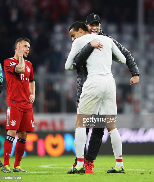 Juergen Klopp head coach of Liverpool congratulates Joel Matip of Liverpool while Rafinha of Bayern Muenchen is dejected after the UEFA Champions...