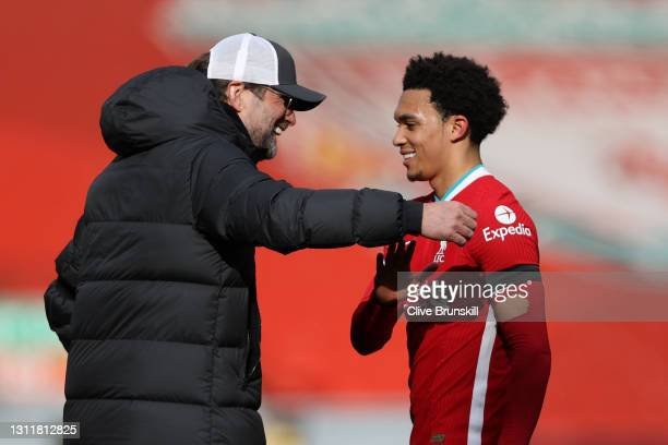 Juergen Klopp, Manager of Liverpool celebrates with Trent Alexander-Arnold of Liverpool following the Premier League match between Liverpool and...