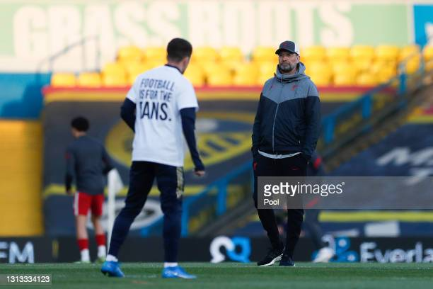 Juergen Klopp, Manager of Liverpool looks on as his team warm up prior to the Premier League match between Leeds United and Liverpool at Elland Road...