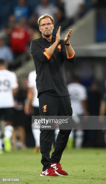 Juergen Klopp of Liverpool applauds the fans after the UEFA Champions League Qualifying PlayOffs Round First Leg match between 1899 Hoffenheim and...