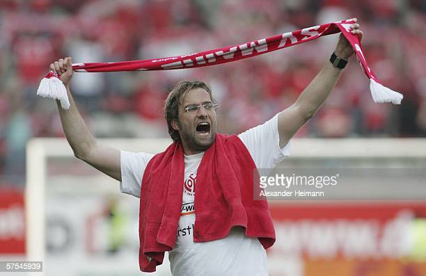 Juergen Klopp of Mainz celebrates the staying in the first division after the Bundesliga match between FSV Mainz 05 and Schalke 04 at the Bruchweg...