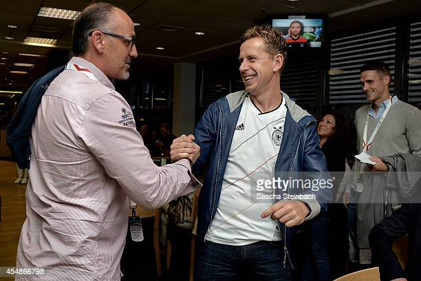 Juergen Kohler and Joerg Heinrich shake hands during the 'Club Of Former National Players' meeting prior to the EURO 2016 qualifier match between...
