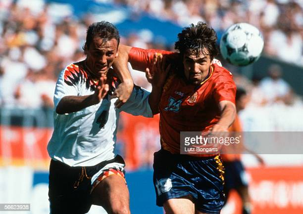 Juergen Kohler of Germany and Julio Salinas of Spain in action during the World Cup match between Germany and Spain on June 21 1994 in Chcago United...