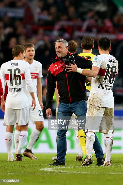 Juergen Kramny head coach of Stuttgart celebrates victory with his palyer Filip Kostic after winning the Bundesliga match between VfB Stuttgart and...
