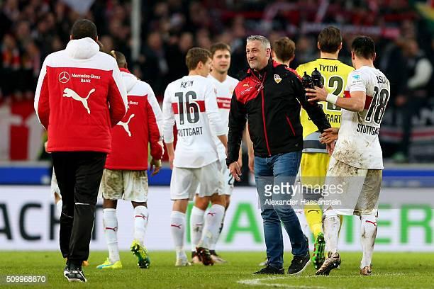 Juergen Kramny head coach of Stuttgart celebrates victory with his palyer Filip Kostic after winning the Bundesliga match between VfB Stuttgart and...
