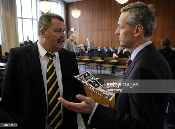 Juergen Ladbeck, left, former works council chairman and former Mannesmann AG corporate director Dietmar Droste, right, wait for the Mannesmann...
