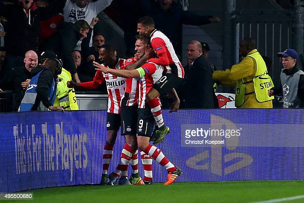 Juergen Locadia of Eindhoven celebrates the first goal with his team mates during the UEFA Champions League Group B match between PSV Eindhoven and...