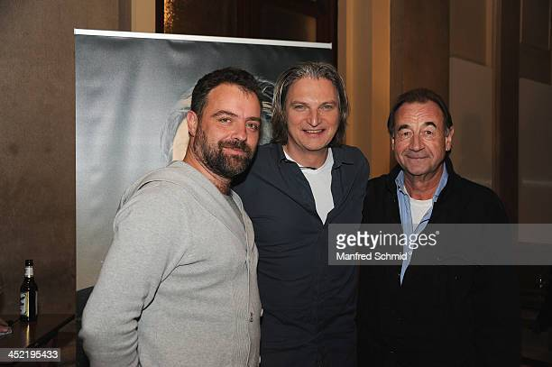 Juergen Maurer Stefan Juergens and Dietrich Sigl pose for a photograph during the 'Alles Immer Moeglich' record presentation at Odeon on November 26...