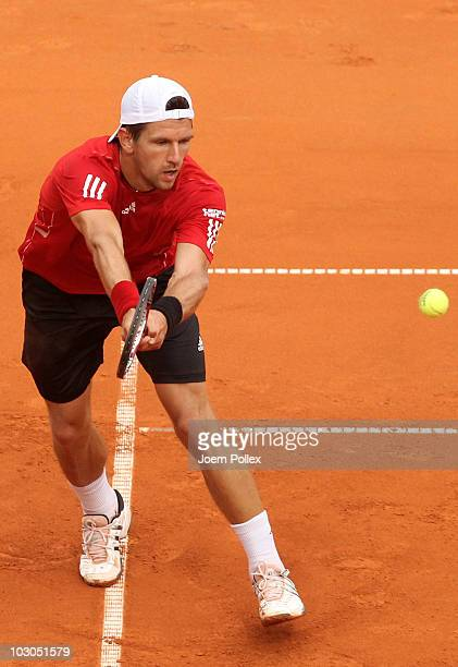 Juergen Melzer of Austria returns a forehand during his Quarter Final match against Potito Starace of Italy during the International German Open at...