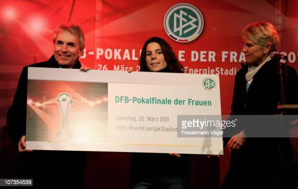 Juergen Roters mayor of Cologne reveives the first ticket from team manager Doris Fitschen and Uschi Holl during the ticket sales start for the...