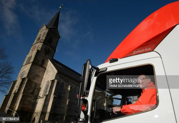 Juergen Schaller employee of the savings bank Sparkasse poses for a photo in a mobile office bus in Tschirn southern Germany on January 30 2018 Bank...