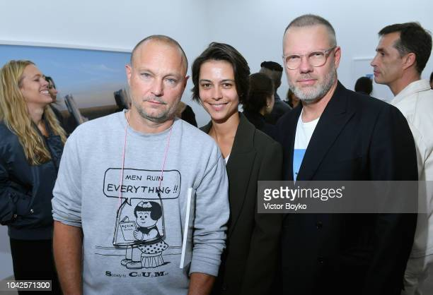 Juergen Teller guest and Jonny Johansson attend exhibition hosted by Acne Studios featuring Cindy Crawford Sam Abell and Amarrillo on at Galerie...