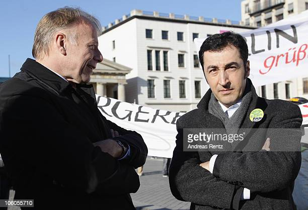 Juergen Trittin, the chairman of the Greens-fraction in the Bundestag chats with Cem Oezdemir, chairman of the Greens party, during a protest to the...