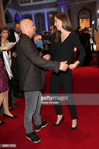Juergen Vogel and Alexandra Maria Lara during the presentation of the Jaguar Land Rover vehicles starring in the new Bond film 'Spectre' on September...
