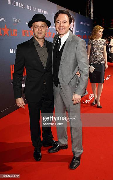Juergen Vogel and Michael 'Bully' Herbig attend the Hotel Lux Premiere at CineStar on October 26 2011 in Berlin Germany