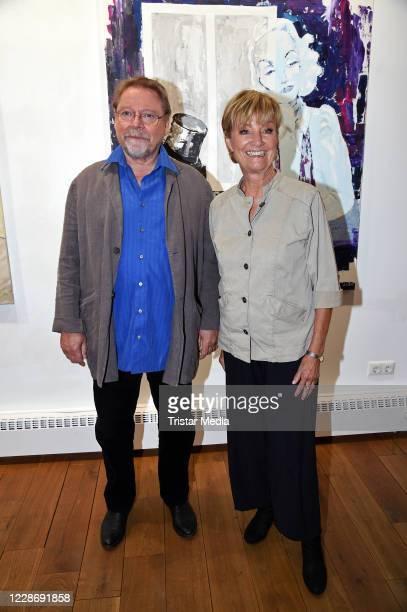 """Juergen von der Lippe and his wife Anne Dohrenkamp during the """"AENO Malerei und Fotografie - Anne Dohrenkamp and André Kowalski"""" exhibition opening..."""