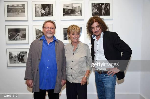 """Juergen von der Lippe, his wife Anne Dohrenkamp and Andre Kowalski during the """"AENO Malerei und Fotografie - Anne Dohrenkamp and André Kowalski""""..."""
