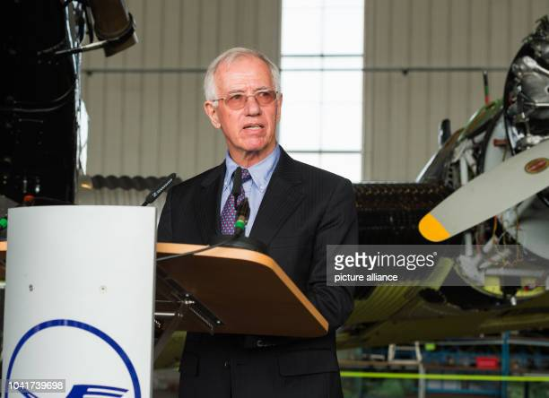 Juergen Weber a former Lufthansa manager gives a talk in front of a historic Junkers Ju 52 aircraft in a hangar in Hamburg Germany 6 April 2017 The...