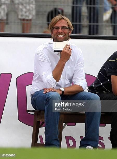 Juerrgen Klopp of Dortmund looks on during the Halleluja Cup match between RotWeiss Essen and Borussia Dortmund at the Lohrheide stadium on July 6...