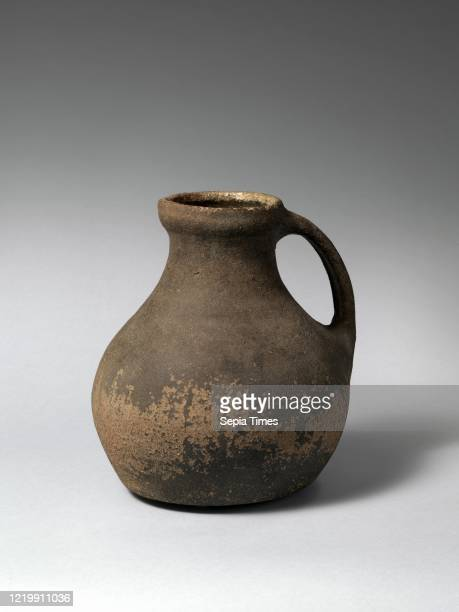 Jug. 13thÐ14th century. Made in Wiltshire. England. British. Unglazed earthenware. 9 5/8 _ 9 _ 8 3/8 in. . Ceramics-Pottery. This bulbous jug is...