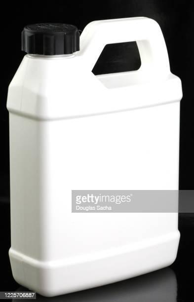 jug of engine antifreeze fluid on a black background - ヤードポンド法 ストックフォトと画像