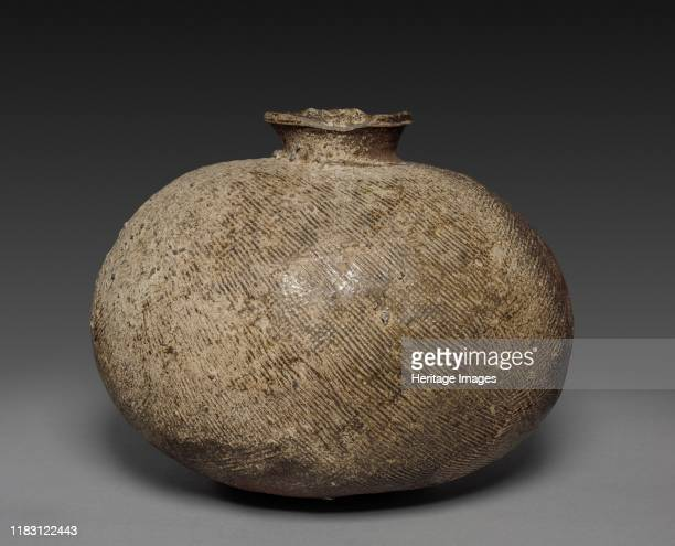 Sueki Ware, 8th century. The unusual shape of this sturdy vessel derives from two deep bowl forms being joined together at their mouths. An opening...