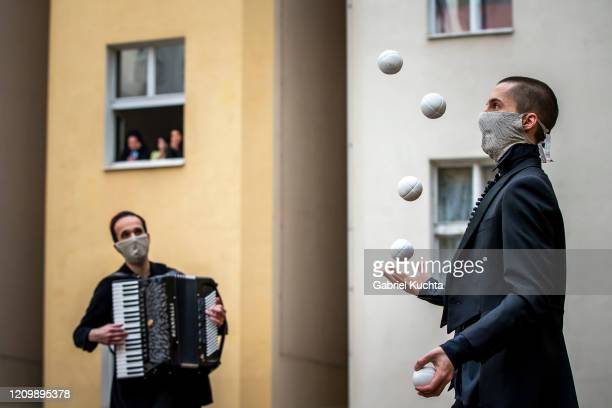 Juggler member of the artistic group Cirk La Putyka performs to entertain residents as the spread of the coronavirus disease continues on April 14,...