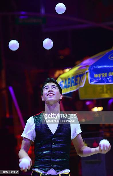 Juggler Ty Tojo performs an act during 'Luminocity' by the Big Apple Circus in New York on October 26 2013 Tojo is the Guinness world record holder...