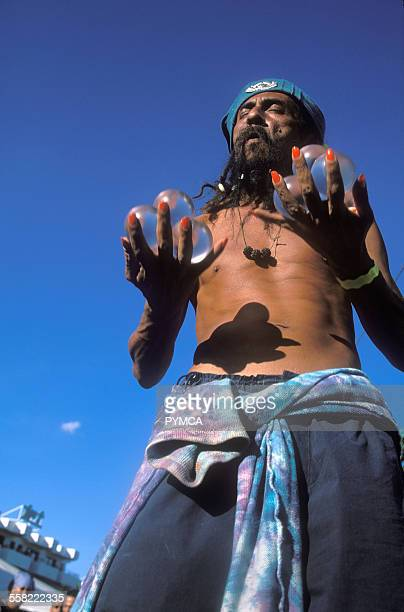 A juggler with painted nails entertaining Ibiza 2004