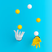 Juggling balls hands out of the wall