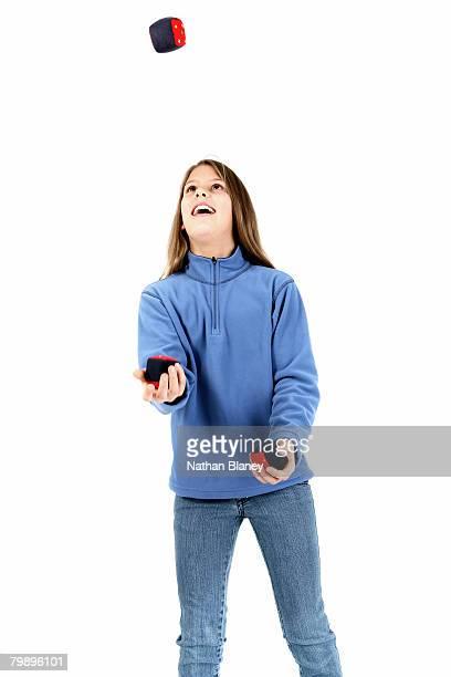 juggling girl. - fleecejas stockfoto's en -beelden
