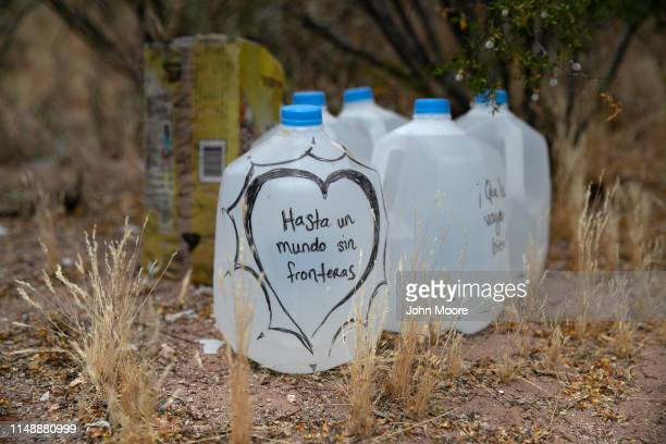 Jugs of water for undocumented immigrants sits along migrant trails after being delivered by volunteers for the humanitarian aid group No More Deaths...